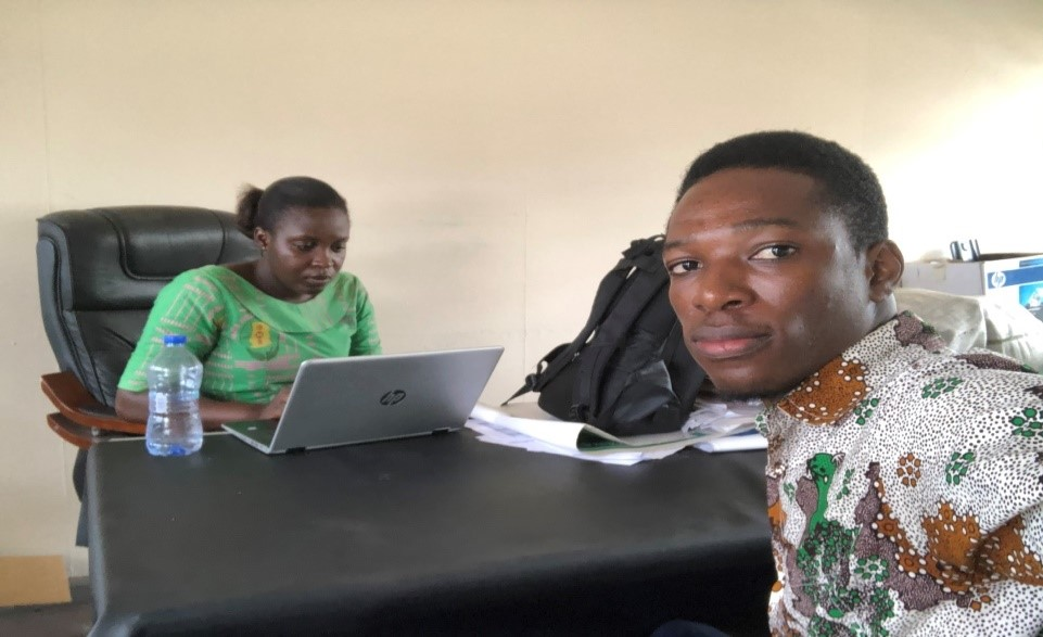 Meeting with the Malaria focal person (Michael in front, Mary Mensah behind) March 2020