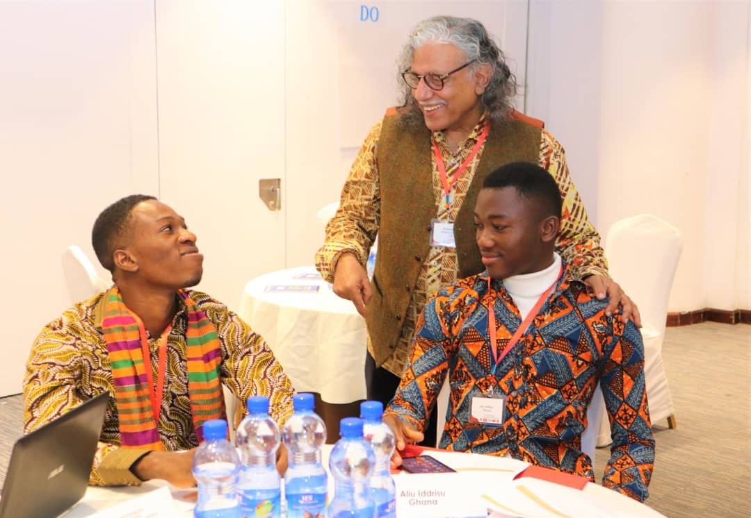 Training and mentoring in Addis Ababa, Ethiopia (Michael on the left and youth leader Iddrisu Aliu on the right interacting with one of the trainers Push standing) January 2020
